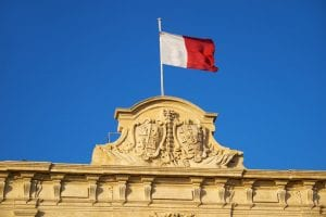 Maltese Flag waving on top of building
