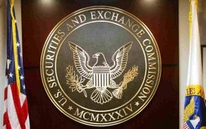 US SEC Logo on wooden wall with United States flag in background