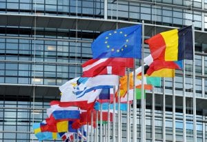 Various flags from EU member states waving in the wind