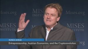 Patrick Byrne speaking in front of crowd about security tokens