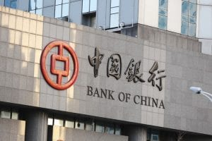 Front of grey building that says Bank of China with Chinese characters