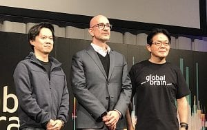 Three men standing at the global brain alliance forum 2019 talking about security tokens in Japan