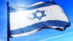 Israeli Flag waving in the wind with blue sky and sun in the background