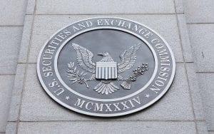 U.S. SEC Metallic Logo outside of stone building