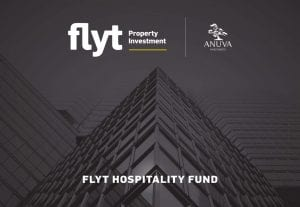 Tall building with sky in background, and 'Flyt Hospitality Fund' in white font