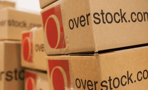 Overstock cardboard boxes stacked on top of each other with 'overstock.com' written on them